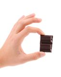 Hand hold two pieces of chocolate Stock Photos