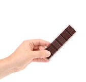 Hand hold two pieces of chocolate. Stock Photo