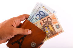 Hand hold wallet of Euros Stock Photo