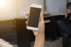 Hand hold white smart phone Stock Images