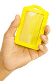 Hand hold Yellow leather tag Stock Images