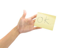 Hand hold yellow paper Royalty Free Stock Photography