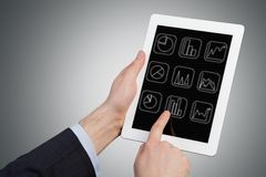 Hand holdin Tablet. Hand holding and Touch on Tablet Computer Royalty Free Stock Images