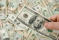 Hand holding 100 bill Stock Photos
