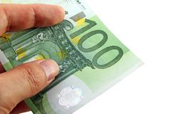 Hand holding a 100 euro bill Stock Photo