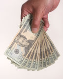 Hand holding $20 bills. MAle hand holds a stack of twenty dollar bills against a white background Stock Photos