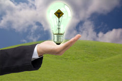 Hand holding. Business man holding light bulb Stock Photos