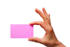 Hand Holding A Pink Sheet Of Paper Stock Photography