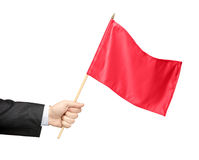 Hand Holding A Red Flag Royalty Free Stock Image