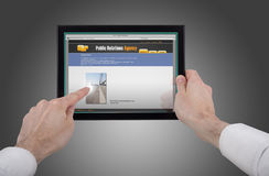 Free Hand Holding A Touchpad Pc And Surfing The Web Stock Photos - 14085613