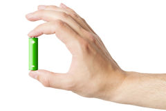 Hand holding an AA battery, isolated Royalty Free Stock Photos