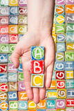 Hand holding abc letters Stock Photos