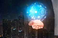 Future and global concept. Hand holding abstract digital business hologram on night city background. Future and global concept. 3D Rendering Royalty Free Stock Photography