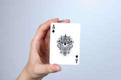 Hand holding ace card. Hand holding single highest card - ace Stock Images