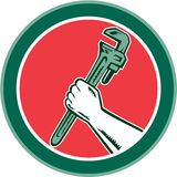 Hand Holding Adjustable Wrench Circle Woodcut Stock Photo
