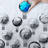 Hand holding air balloons with crumpled paper Stock Photo