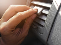 Hand holding air conditioner vents car. Royalty Free Stock Photography