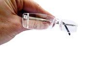 Hand holding air of rimless eye glasses, reading glasses Stock Photo