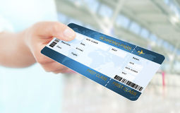 Hand holding air ticket on airport Stock Photos