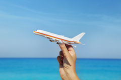 Hand holding airplane miniature Stock Images