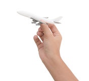 Hand holding airplane toy model isolated on white background Royalty Free Stock Photography