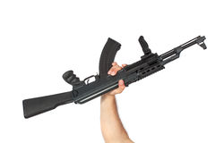 Hand holding AK-47 machine gun Royalty Free Stock Image