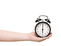 Hand holding alarm clock Royalty Free Stock Photos