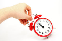 Hand holding alarm clock Stock Photo