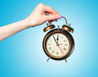 Hand holding alarm clock Royalty Free Stock Photography