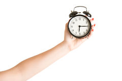 Hand Holding an Alarm Clock Royalty Free Stock Photography