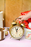 Hand holding alarm clock over christmas Stock Images