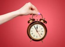Hand holding alarm clock Royalty Free Stock Photo