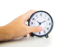 Hand holding alarm clock Royalty Free Stock Photography