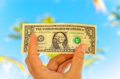 Hand holding an american dollar stock image