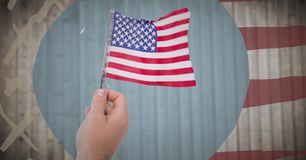 Hand holding american flag against blurry wood panel with hand drawn american flag Stock Images