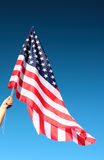 Hand holding american flag Stock Image