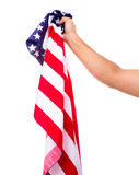 Hand holding American flag isolated. On white background Stock Image