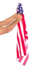 Hand holding American flag isolated. On white background Royalty Free Stock Photography