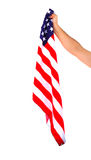 Hand holding American flag isolated. On white background Royalty Free Stock Image