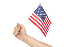 Hand holding American flag. Isolated on white background Stock Photography