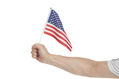 Hand holding American flag  on white Royalty Free Stock Photo
