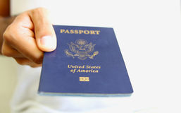Hand Holding an American Passport Isolated Royalty Free Stock Images