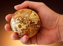 Hand holding antique globe (Asia Region) Royalty Free Stock Photos