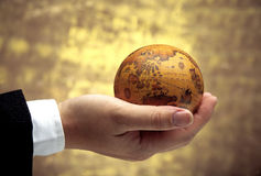 Hand holding antique globe (Asia Region) stock photos