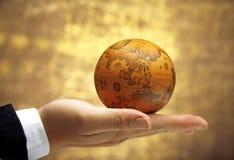 Hand holding antique globe (Asia Region) stock photo