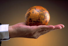 Hand holding antique globe (Asia Region) royalty free stock photography