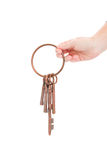 Hand holding skeleton keys on ring. Hand holding antique ring of keys isolated on white background Stock Image