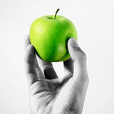 Hand holding apple Stock Photos
