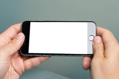Hand Holding An Apple iPhone 6 With Blank Screen. Berlin; Germany - October 10; 2014: Cropped image of hand holding an Apple iPhone 6 with blank screen. Apple Royalty Free Stock Image