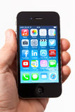 Hand Holding Apple iPhone 4s Stock Images